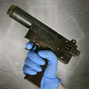 A captive bolt pistol.